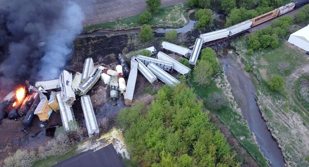 Fire is seen on a Union Pacific train carrying hazardous material that has derailed in Sibley, Iowa, US, in this still frame obtained from social media drone video dated 16 May 2021.