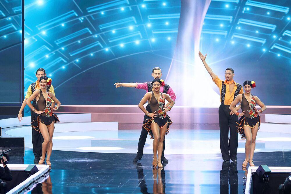 Dancers perform onstage.