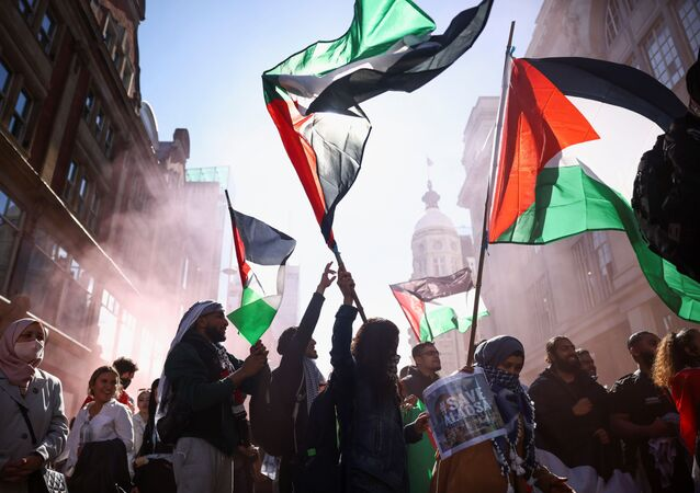 Pro-Palestinian demonstrators hold Palestinian flags, as they attend a protest following a flare-up of Israeli-Palestinian violence, in London, Britain, May 15, 2021.