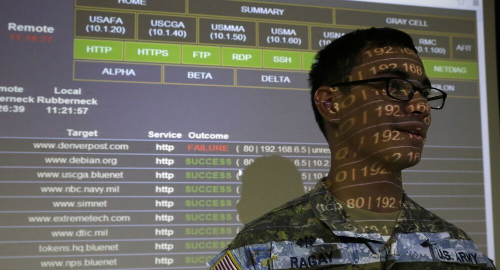 United States Military Academy cadet Kiefer Ragay stands in a projection of data results, as he talks to fellow cadets at the Cyber Research Center at the United States Military Academy in West Point, N.Y., Wednesday, April 9, 2014.