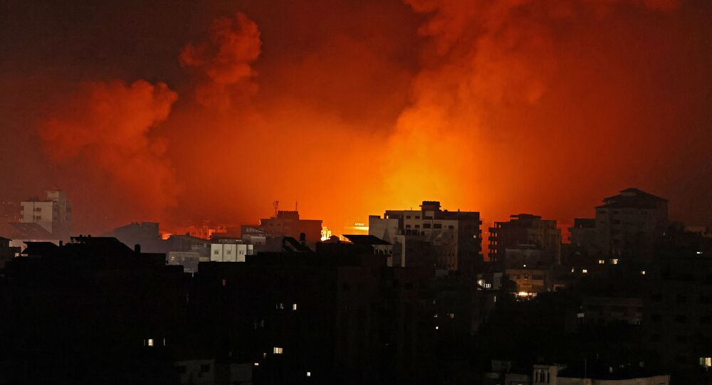 Smoke billows from a fire following Israeli airstrikes on multiple targets in Gaza City, controlled by the Palestinian Hamas movement, early on May 16, 2021.