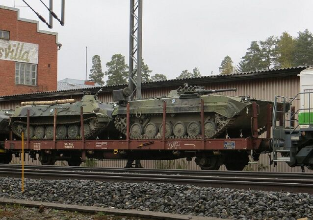 A Finnish BMP-1 TJJ artillery observation vehicle (right) and a MT-LBv armoured personnel carrier (left)
