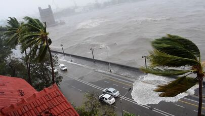 Waves crash onto the road as Cyclone Tauktae batters Mumbai, India a still image taken from social media video.