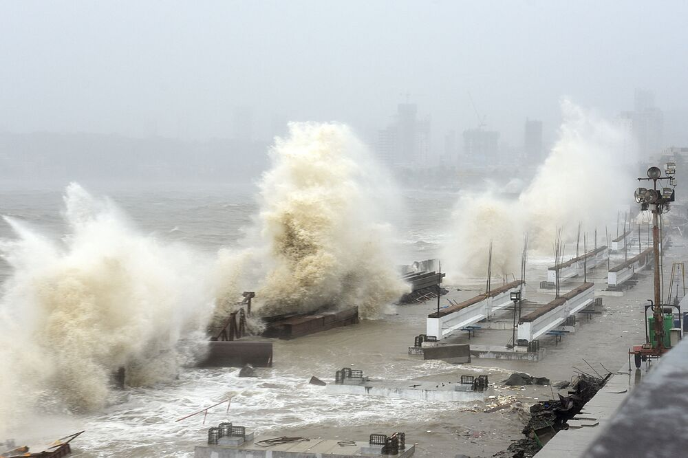 Waves lash over onto a shoreline in Mumbai, as Cyclone Tauktae, packing ferocious winds and threatening a destructive storm, surge bore down on India, disrupting the country's response to its devastating Covid-19 outbreak.