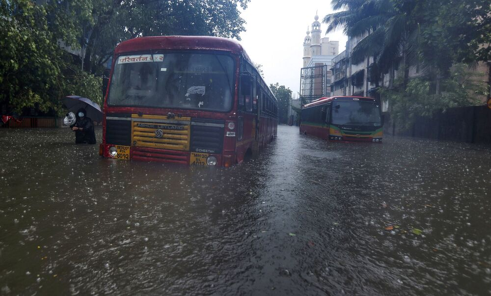 Buses are stranded on a waterlogged road during heavy rain in Mumbai, India. Cyclone Tauktae, roaring in the Arabian Sea was moving toward India's western coast on Monday as authorities tried to evacuate hundreds of thousands of people and suspended COVID-19 vaccinations in one state.