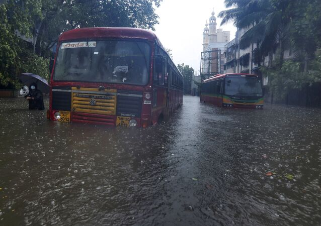 Buses are stranded on a waterlogged road during heavy rain in Mumbai, India