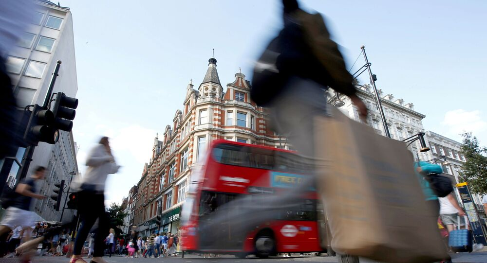 Shoppers cross the road in Oxford Street, in London, Britain (File)