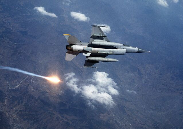 F-16 Fighting Falcon aircraft releases a flare