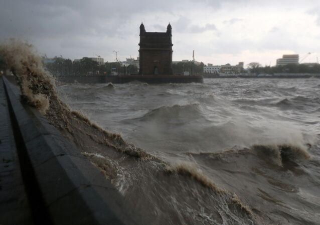 Waves caused by Cyclone Tauktae crash up on the promenade near the Gateway of India monument in Mumbai, India, 17 May 2021