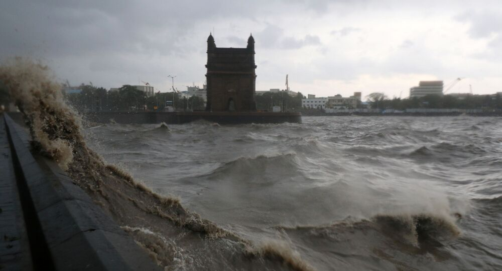Waves caused by Cyclone Tauktae crash up on the promenade near the Gateway of India monument in Mumbai, India, May 17, 2021