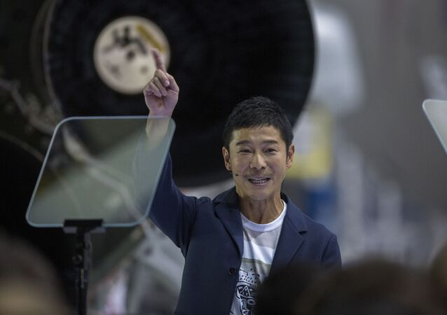 Japanese billionaire Yusaku Maezawa reacts near a Falcon 9 rocket during the announcement by Elon Musk to be the first private passenger who will fly around the Moon aboard the SpaceX BFR launch vehicle, at the SpaceX headquarters and rocket factory on September 17, 2018 in Hawthorne, California