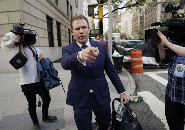 Andrew Giuliani, center, son of former New York City Mayor Rudy Giuliani, leaves his father's apartment, Wednesday, April 28, 2021, in New York