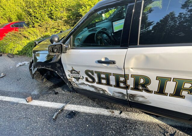 "On Saturday, a deputy responded to a collision in the 25200 block of 103rd Ave NE where a vehicle sheared a power pole in half. The deputy parked on the shoulder on the road, with his emergency lights flashing, and exited his vehicle to speak with the Fire units on scene. Approximately 30 seconds later, a Tesla in ""autopilot"" mode, struck the deputy's vehicle causing significant damage. Thankfully, there were no injuries from this collision. This is a great reminder that vehicles may have autopilot to assist, but it cannot be relied upon to get you safely from one destination to the next."