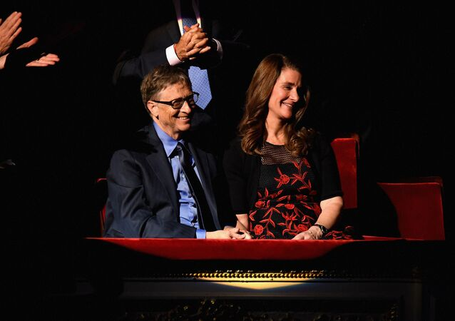 Bill Gates (L) and Melinda Gates attends the ONE Campaign and (RED)s concert to mark World AIDS Day, celebrate the incredible progress thats been made in the fights against extreme poverty and HIV/AIDS, and to honor the extraordinary leaders, dedicated activists, and passionate partners who have made that progress possible. At Carnegie Hall on December 1, 2015 in New York City.