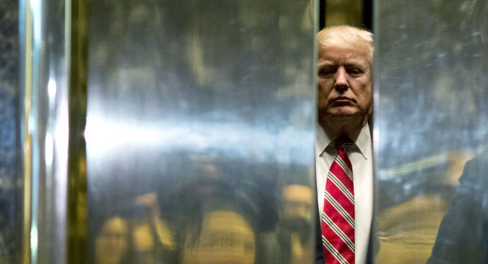 In this file photo taken on January 16, 2017 US President-elect Donald Trump boards the elevator after escorting Martin Luther King III to the lobby after meetings at Trump Tower in New York City. - The Trump Organization is being investigated in a criminal capacity as New York prosecutors advance their probe into former president Donald Trump's business dealings, the state attorney general announced Tuesday. We have informed the Trump Organization that our investigation into the organization is no longer purely civil in nature, a spokesman for Attorney General Letitia James' office said. We are now actively investigating the Trump Organization in a criminal capacity, along with the Manhattan DA.