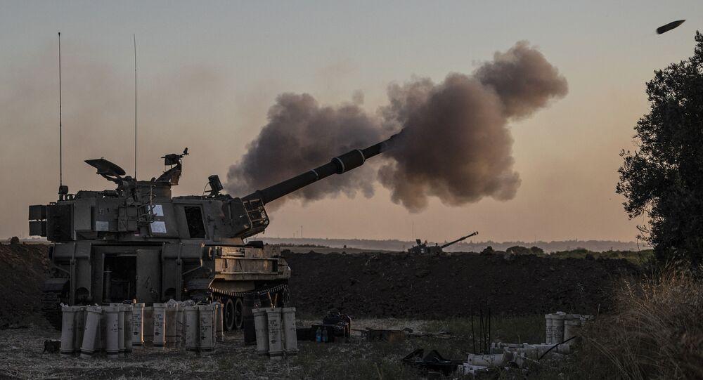An Israeli artillery unit fires toward targets in Gaza Strip, at the Israeli Gaza border, Tuesday, May 18, 2021