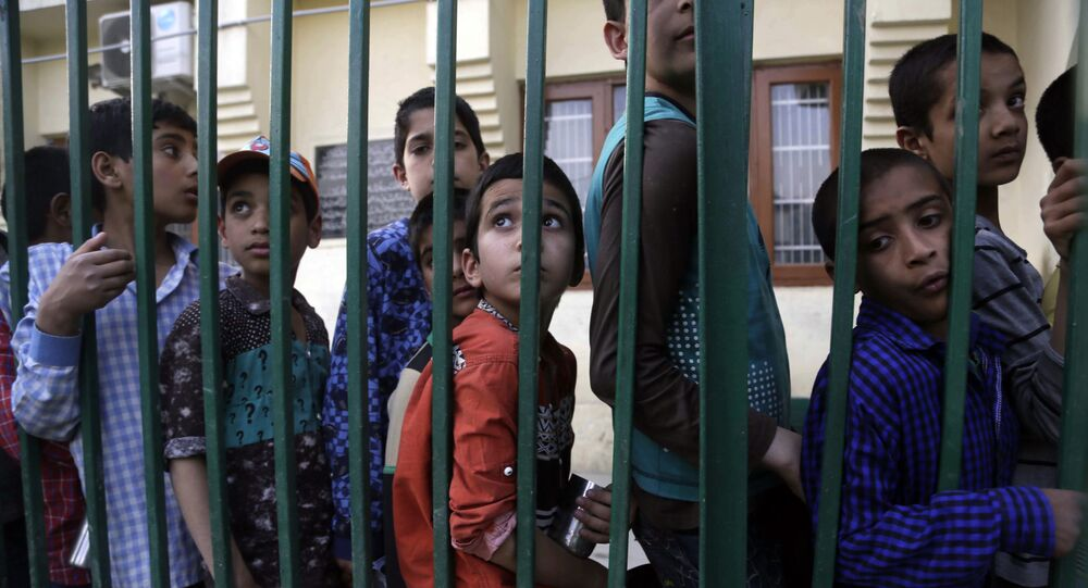 Kashmiri orphans stand in a queue for food before Iftar, the meal, at an orphanage in Srinagar, Indian-controlled Kashmir, Thursday, May 31, 2018