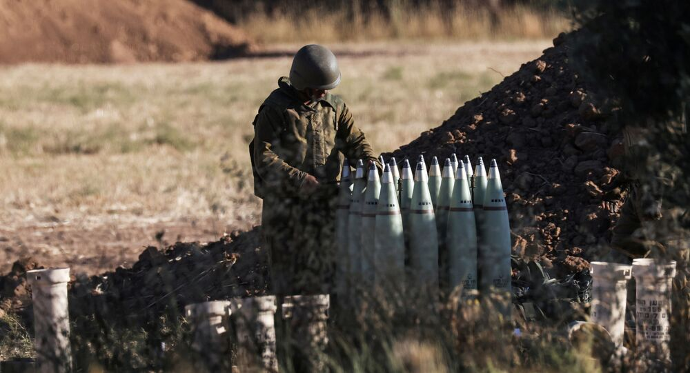 An Israeli soldier works at an artillery unit near the border between Israel and the Gaza strip, on the Israeli side May 18, 2021