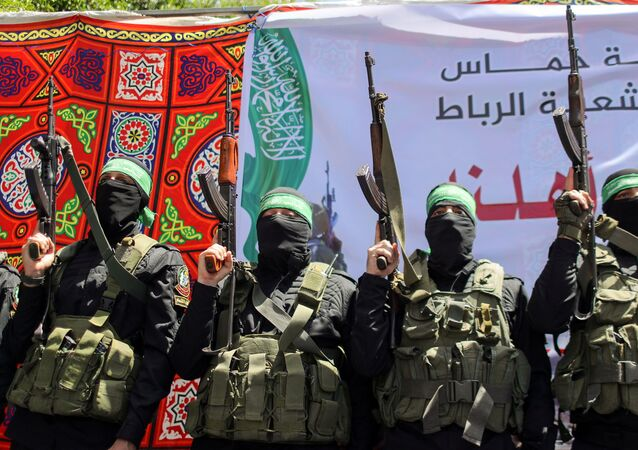 Palestinian Hamas militants take part in a protest over the possible eviction of several Palestinian families from homes on land claimed by Jewish settlers in the Jerusalem's Sheikh Jarrah neighbourhood, in the northern Gaza Strip May 7, 2021