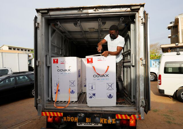 Boxes of Oxford/AstraZeneca coronavirus disease (COVID-19) vaccines, redeployed from the Democratic Republic of Congo, are seen loaded onto a refrigerated delivery truck in Accra, Ghana, May 7, 2021