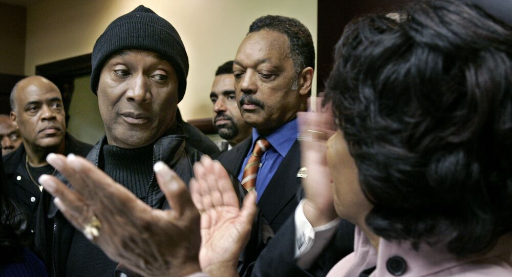 U.S. Rep. Maxine Waters, D-Los Angeles, right, with Rev. Jesse Jackson, second from right, applauds comedian Paul Mooney, second from left, who agreed to stop using the n-word during a news conference Monday, Nov. 27, 2006, in Los Angeles, in response to Michael Richards' recent tirade at a Los Angeles comedy club.