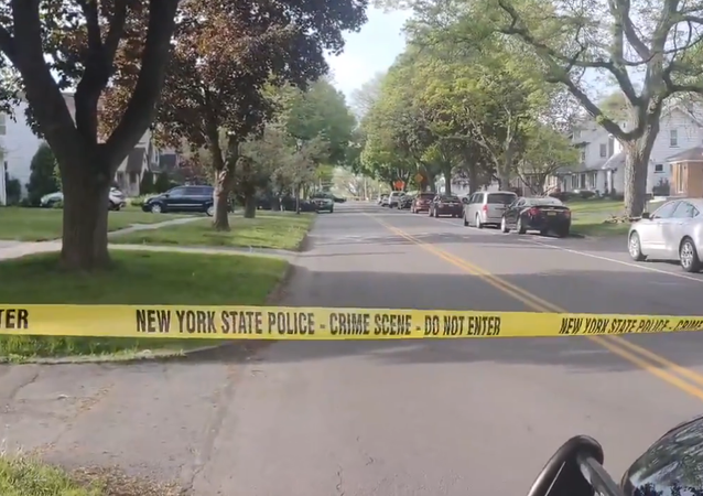 Screenshot from a video filmed at 93 Woodman Park, Rochester, New York, at the residence of Rochester Mayor Lovely Warren, where state troopers have arrived to conduct a criminal investigation