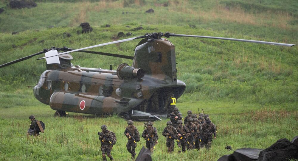 French soldiers walk from a Chinook helicopter during a joint military drill between Japan Self-Defense Forces, French Army and U.S. Marines, at the Kirishima exercise area in Ebino, Miyazaki prefecture, Japan May 15, 2021