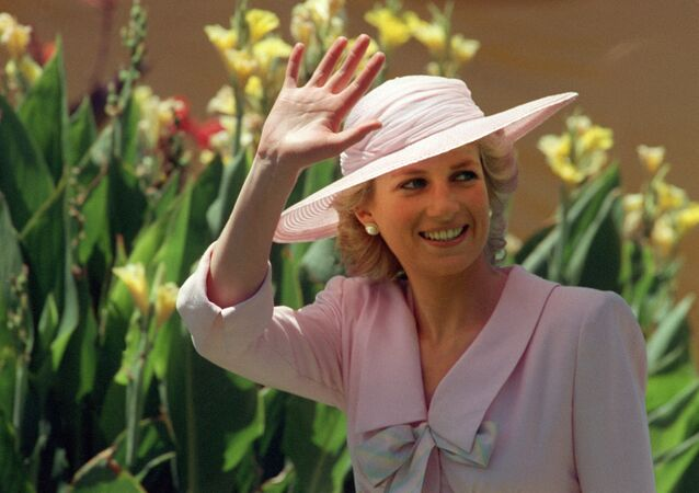 Princess of Wales Diana waves to the crowd, 27 January 1988, during her visit to the Footscray Park in suburb of Melbourne.