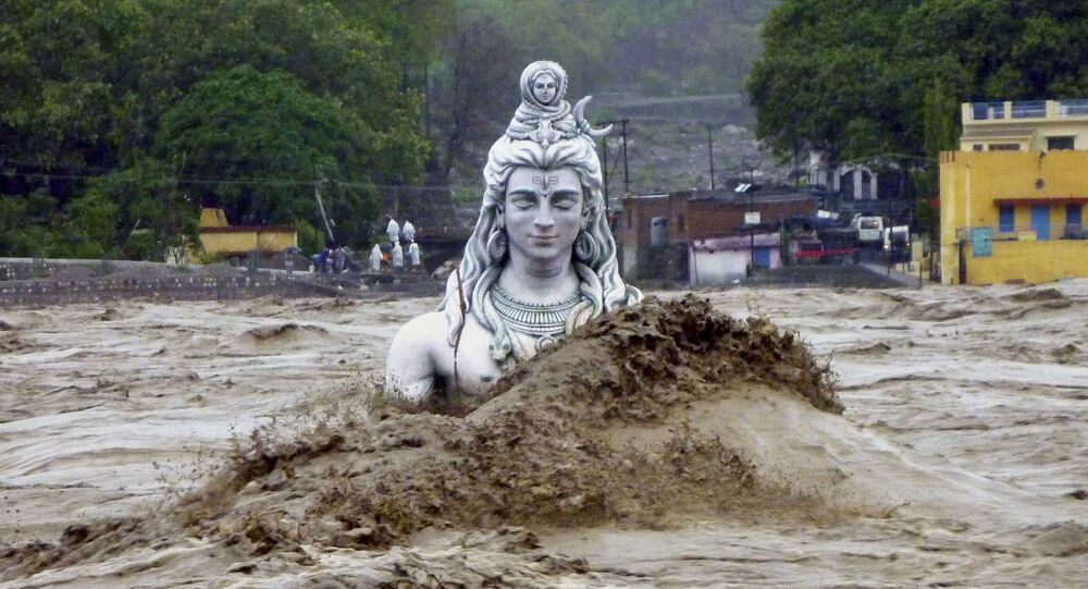 A submerged idol of Hindu Lord Shiva stands in the flooded River Ganges in Rishikesh, in the northern Indian state of Uttarakhand, India (File)