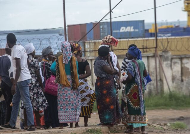 People wait on the outskirts of the seaport of Pemba on March 30, 2021 for the possible arrival of their families evacuated from the coasts of Afungi and Palma after the attack by armed forces against the city of Palma on March 24, 2021. -