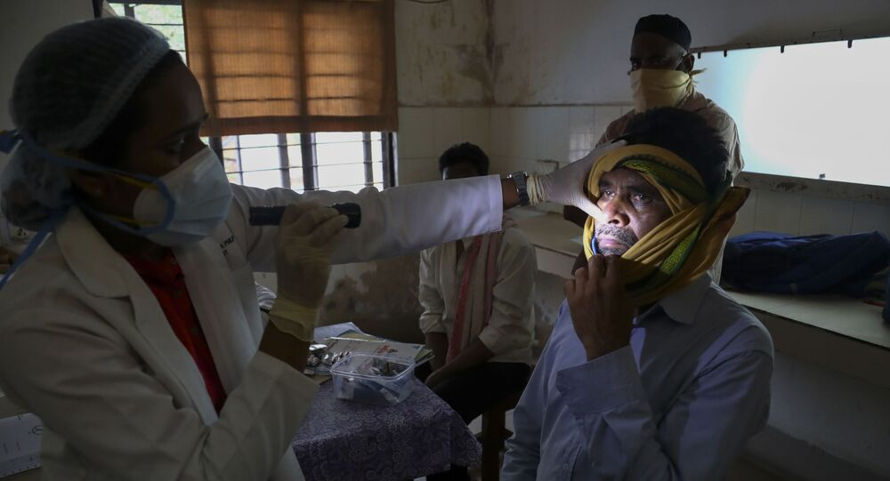 An Indian doctor checks a man who recovered from COVID-19 and now infected with black fungus at the Mucormycosis ward of a government hospital in Hyderabad, India, Thursday, May 20, 2021