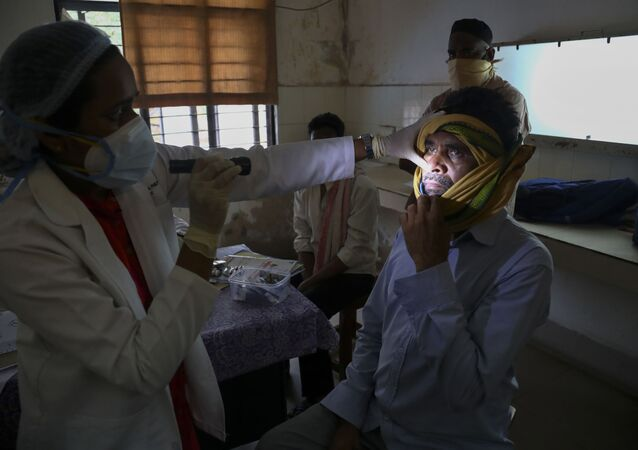 An Indian doctor checks a man who recovered from COVID-19 and now infected with black fungus at the Mucormycosis ward of a government hospital in Hyderabad, India, Thursday, 20 May 2021