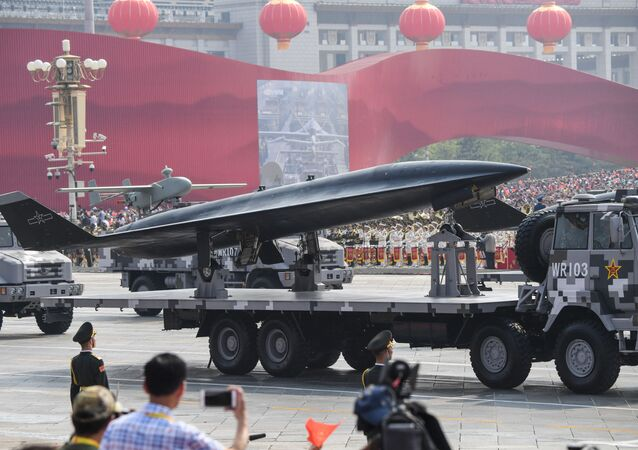 A military vehicle carrying a WZ-8 supersonic reconnaissance drone takes part a military parade at Tiananmen Square in Beijing on October 1, 2019, to mark the 70th anniversary of the founding of the People's Republic of China. (Photo by GREG BAKER / AFP)