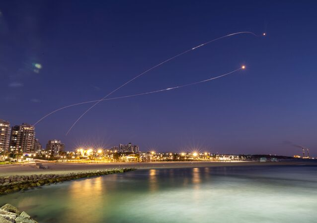 Streaks of light are seen as Israel's Iron Dome anti-missile system intercept rockets launched from the Gaza Strip towards Israel, as seen from Ashkelon May 19, 2021