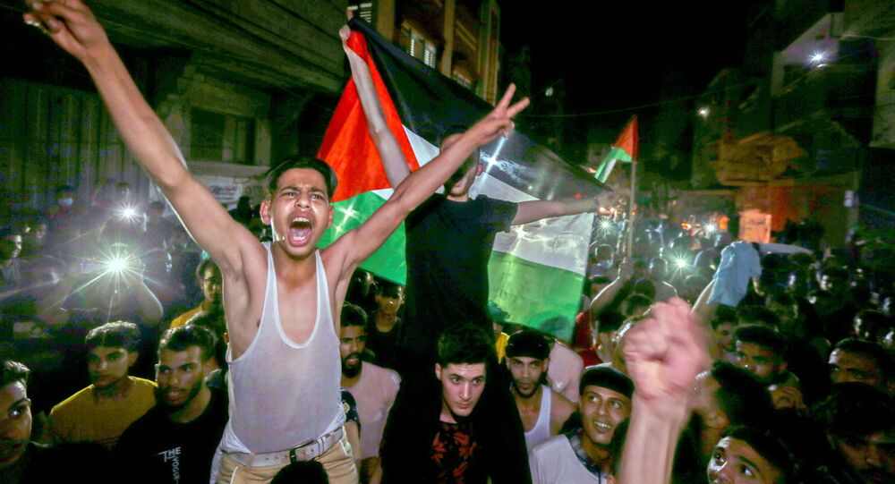 Palestinians celebrate in the streets following a ceasefire, in the southern Gaza Strip May 21, 2021.
