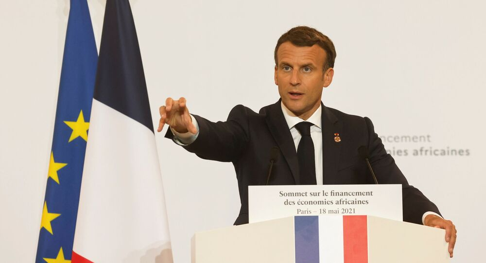 France's President Emmanuel Macron speaks during a joint news conference at the end of the Summit on the Financing of African Economies in Paris, France May 18, 2021. Ludovic Marin/Pool via REUTERS