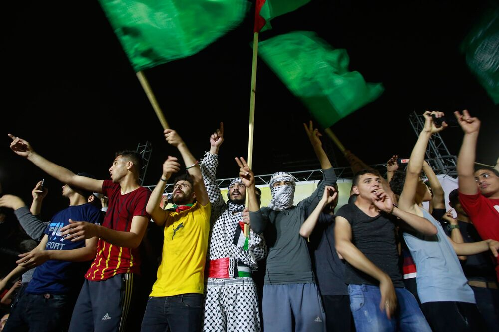 Palestinians celebrate the ceasefire brokered by Egypt between Israel and Hamas.