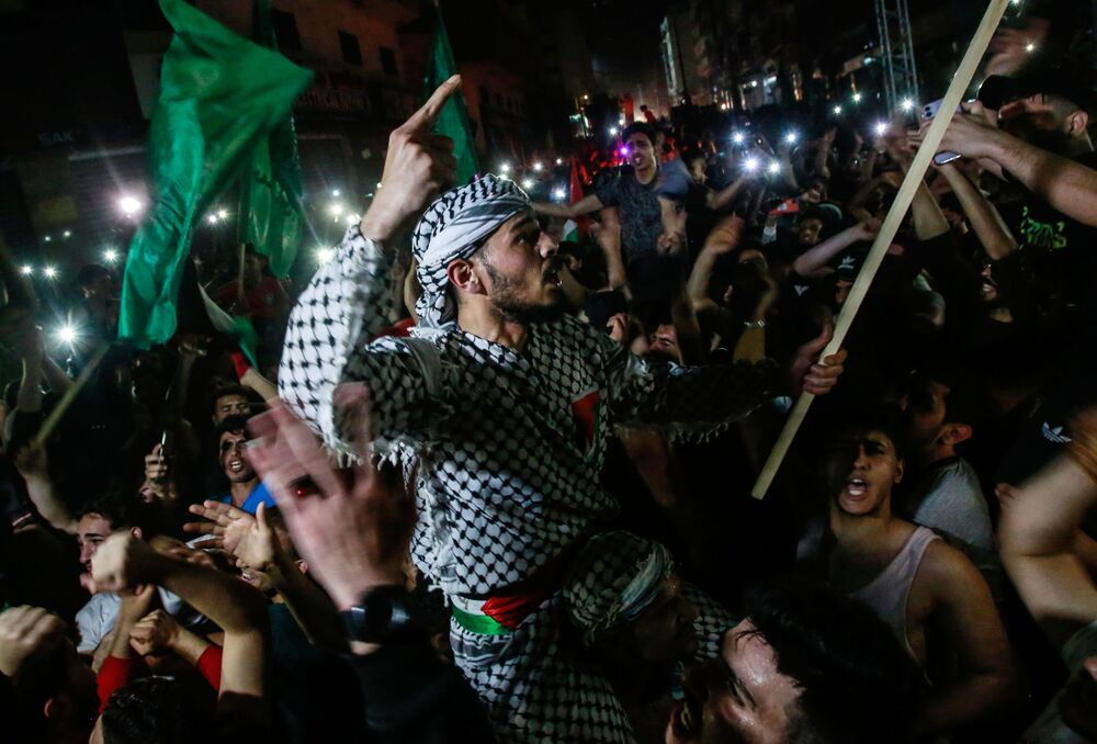 Palestinians celebrate the truce that came into effect at 2 a.m. local time.