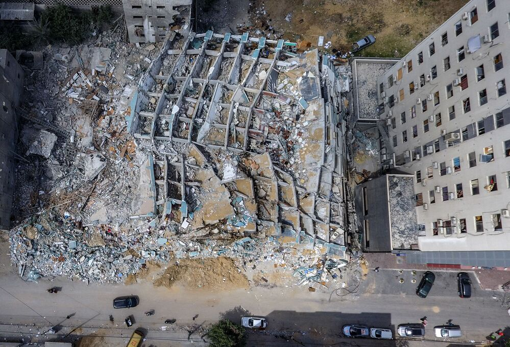This aerial view shows the Al-Jalaa Tower in Gaza City that was levelled by an Israeli airstrike during the recent military conflict between Israel and the Palestinian enclave governed by Hamas, after the ceasefire brokered by Egypt.
