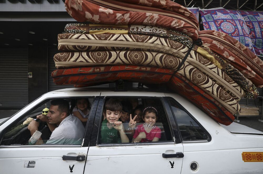 A Palestinian family returns to their house in Gaza City after the ceasefire between Israel and Hamas.