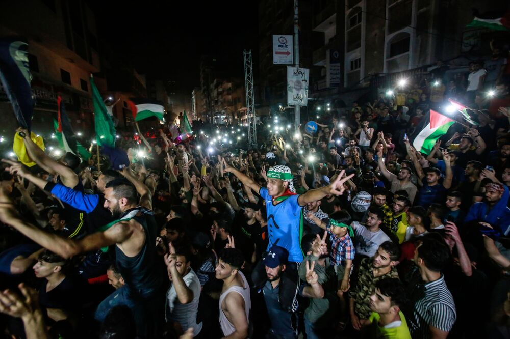Hundreds of Palestinians flocked to the streets in the Gaza Strip to celebrate the ceasefire between Israel and Hamas.