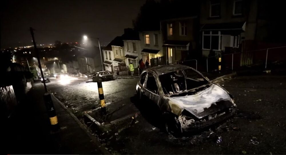 Gangs of young people have set cars on fire and rolled them down a hill in Swansea, Wales UK