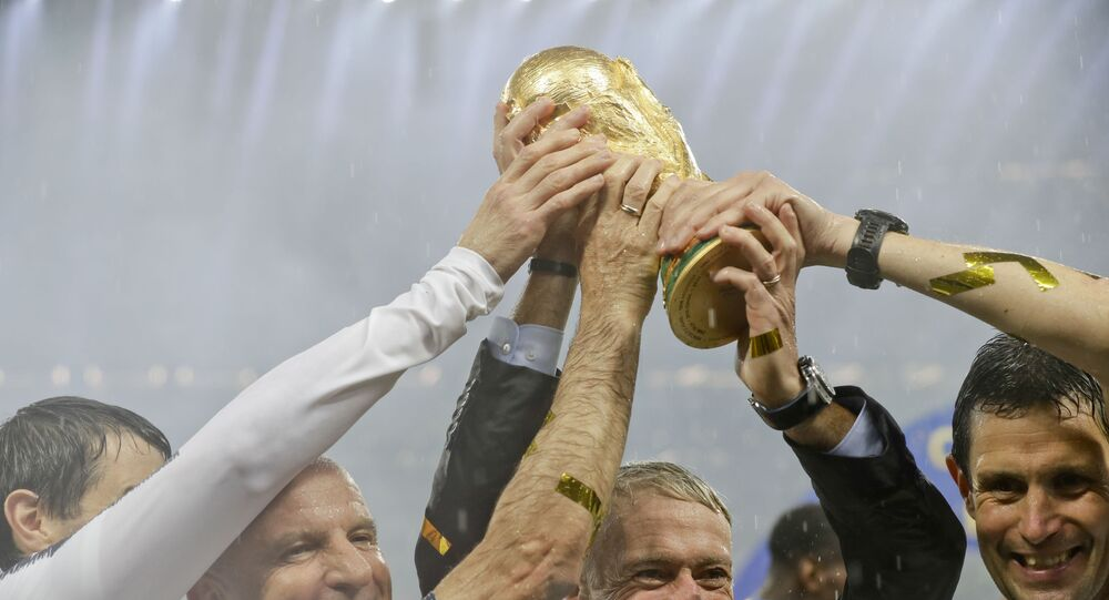 France head coach Didier Deschamps holds the World Cup after defeating Croatia in the 2018 final in Moscow.