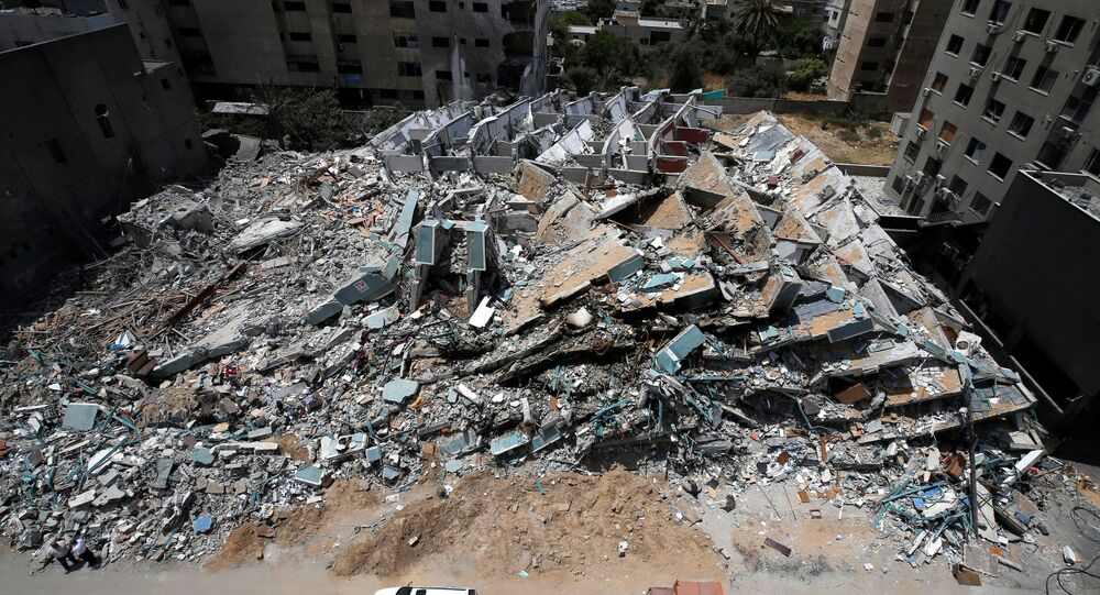 A view shows the remains of a tower building destroyed by Israeli missile strikes in the recent cross-border violence between Palestinian militants and Israel, following Israel-Hamas truce, in Gaza City May 21, 2021