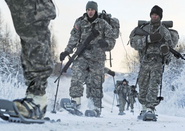 In this 6 December 2012 photo provided by the US Department of Defense, soldiers assigned to 6th Engineer Battalion utilise snow shoes during Arctic Light Individual Training on the Bulldog Trail in sub-zero conditions at Joint Base Elmendorf-Richardson, Alaska.  ALIT is the United States Army Alaska's Cold Weather Indoctrination program. It gives all soldiers, regardless of their job, the foundation to successfully work, train, and go to war in some of the harshest environments in the world.