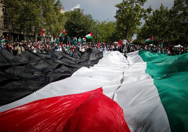 People take part in a protest in support of Palestinians following a flare-up of Israeli-Palestinian violence, on Republique square in Paris, France, May 22, 2021.