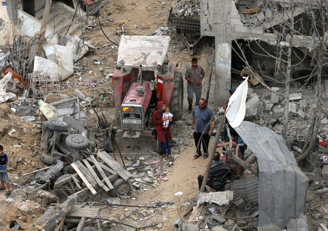 Palestinians return to their houses which were destroyed by Israeli strikes in the recent cross-border violence between Palestinian militants and Israel, following Israel-Hamas truce, in Gaza May 21, 2021