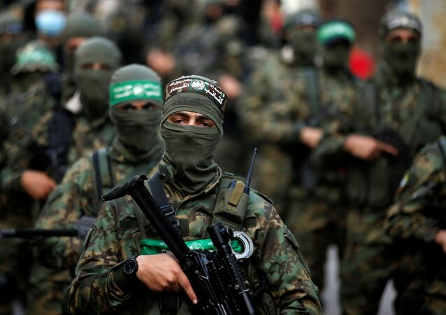 Palestinian Hamas militants take part in an anti-Israel rally in Gaza City on 22 May 2021. REUTERS/Mohammed Salem