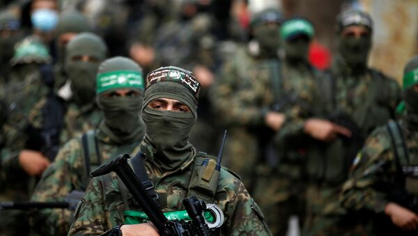 Palestinian Hamas militants take part in an anti-Israel rally in Gaza City on 22 May 2021. REUTERS/Mohammed Salem - Sputnik International
