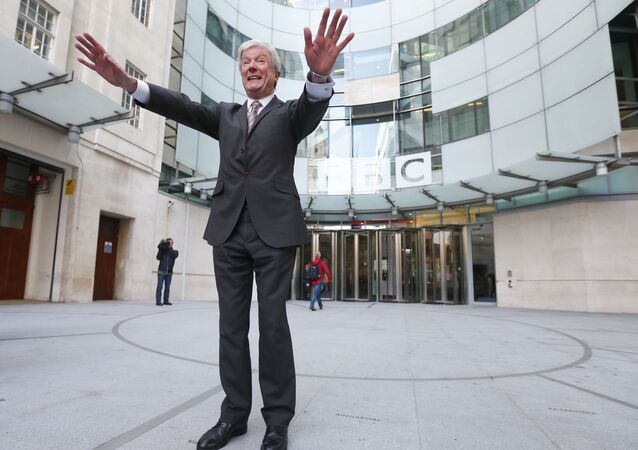 Tony Hall poses for photographers on his arrival at Broadcasting House for his first day as the new Director General of the BBC, in central London April 2, 2013.